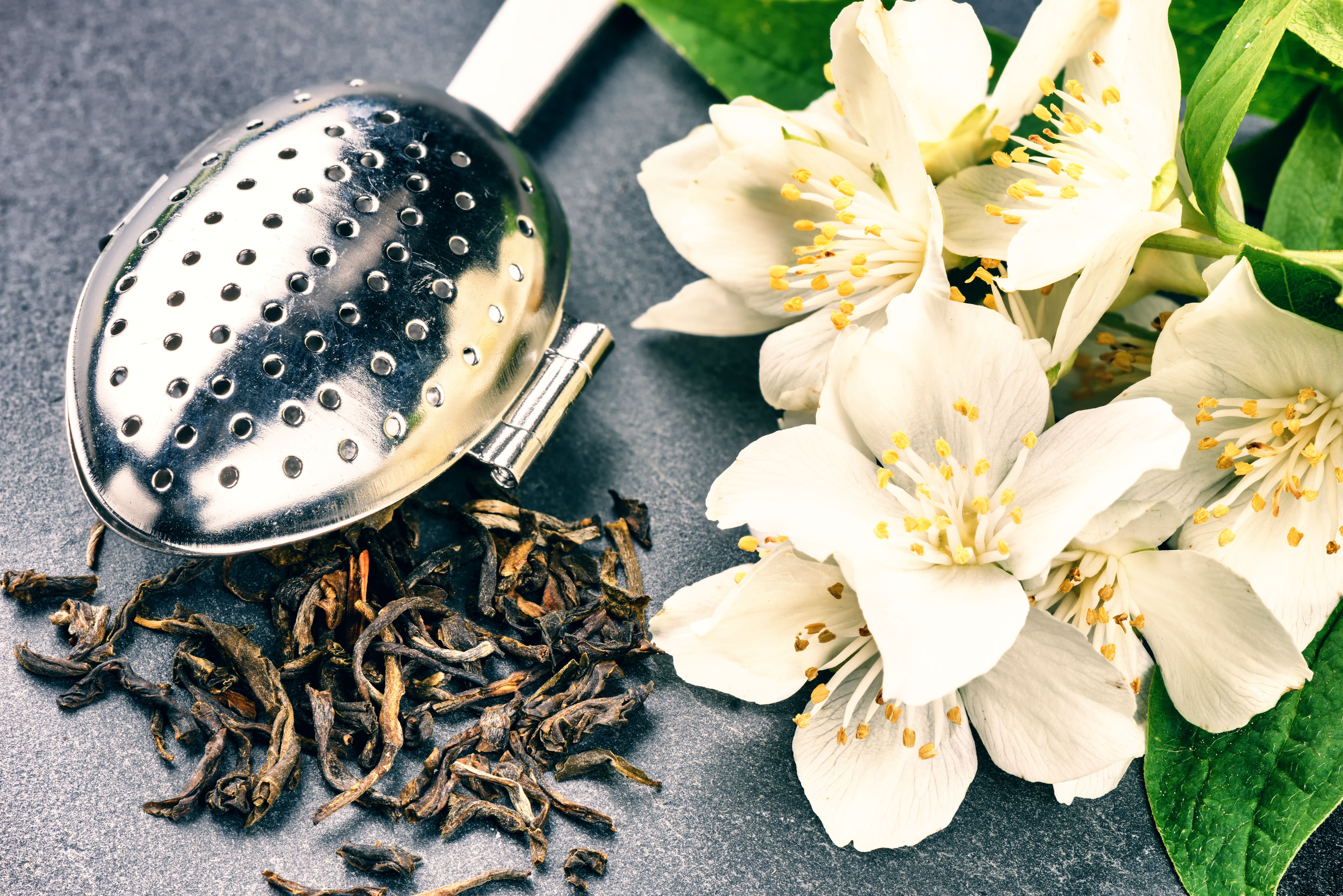 Tea Infuser Spoon With Dry Green Tea Leaves And Jasmine Flowers
